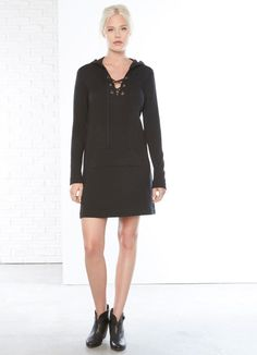 This clever hybrid dress from Fifteen Twenty makes loungewear dressing easier than ever! Cut in the softest fleece knit with on trend lace-up ties and grommets, hood and kangaroo pocket.