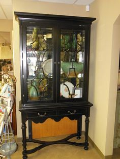 Showroom Clearing Event - Black Cabinet with Antique Mirror $3125.00 / SALE $1562.00. Please contact us for further information, 865-675-1130 or mcentiredesigngroup@gmail.com