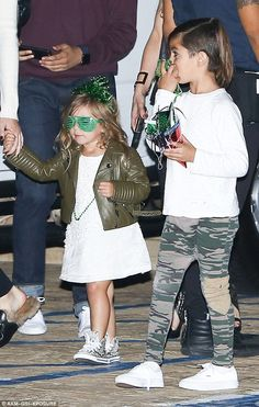 Making memories: Penelope also sported a pair of green shutter shades and a matching tiara as she arrived to the dinner beside her brother Mason