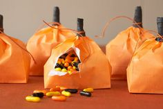 Halloween goodie bags. Orange bag & duct tape for stem.