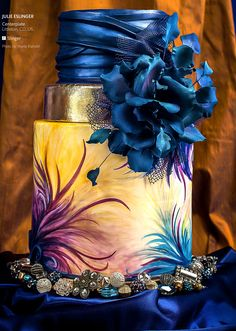 THIS AMAZING!!! Hand painted blue & purple cake, with royal blue swags and gigantic flower. This is beautiful!