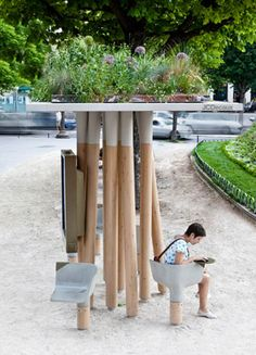Wifi Hotspot / Landscape art, Paris by designer Matheiu Lehanneur.  Seats are concrete with built in electrical outlets.