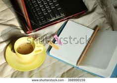 coffee cup with laptop and notebook and Calculator on bed , work at home concept , business idea , business analysis