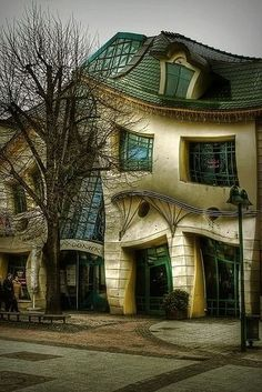 "The Crooked House, Poland has an extraordinary and amazing structure. It was built in 2003 with design based on the pictures of Jan Marcin Szancer and Per Dahlberg. It looks as taken from a cartoon movie, its design is ""crooked"", but a kind of symmetrically, so it is not ugly at all, just strange! The interesting part is how builders managed to create this genius idea, but the house is a fact and everyone admires their creativity!From Top 10 Strangest Buildings in the World"