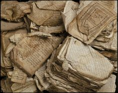 A pile of Hebrew prayerbooks and other Jewish religious texts damaged by fire at the synagogue in Bobenhausen II, District Vogelsberg, durin...