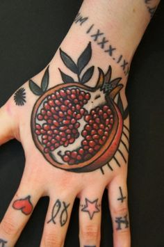 pomegranate hand tattoo by Dane Mancini- i dont know why, but i love this sooo much!! For sure i get this tattoeëd later on my body. Its cute as hell.