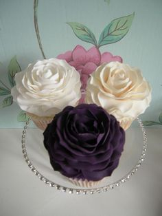 Beautiful roses in white, cream, and violet - too gorgeous to eat #wedding #weddingcupcakes #cupcakes #rose #violet