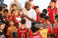 0b39df7fd Former NBA basketball player Dikembe Mutombo signs autograph for.