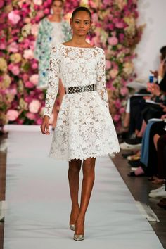 A model walks the runway at the Oscar De La Renta fashion show during Mercedes-Benz Fashion Week Spring 2015 on September 2014 in New York City. Lace Wedding Dress With Sleeves, Lace Dress, Dress Up, White Dress, Dresses With Sleeves, Wedding Dresses, White Lace, Runway Fashion, Fashion Show