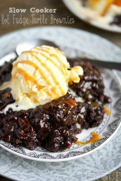 Fabulously gooey and outrageously delicious, these Slow Cooker Hot Fudge Turtle Brownies are going to rock your world! Hot fudge sauce, caramel, pecans, and gooey brownies come together for one irresi