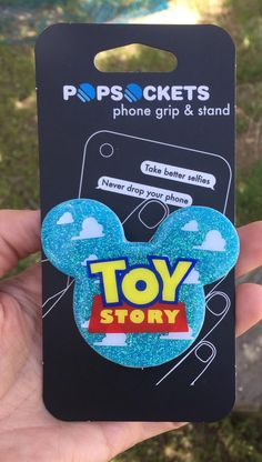 Toy Story Mickey pop grip Mickey head pop socket. Mouse | Etsy Cell Phone Grip, Phone Grip And Stand, Bling Phone Cases, Cute Phone Cases, Disney Pop, Disney Style, Danse Twerk, Popsocket Design, Cute Popsockets