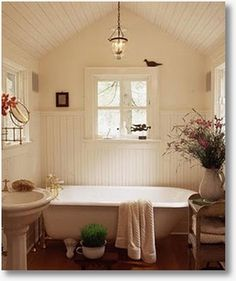 beadboard ceilings and wall paneling combine with amazing window trim in this bath.