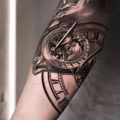 Stunning detailed sundial compass tattoo on arm
