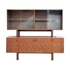A Mid-century burled wood sideboard with floating hutch made by Bernhardt Furniture's high end Flair Division, in the manner of Milo Baughman. In good vintage condition, wear consistent with use and age. Some surface scratches to gloss finish visible at some angles.