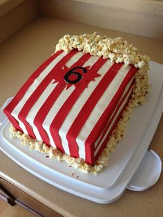 popcorn cake side view. used Wilton Sugar Sheets to decorate and recipe for Cake Batter Popcorn