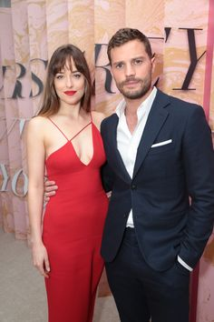 Dakota Johnson and Jaime Dornan at the F I F T Y: Fifty Shades Brought To Life opening in Los Angeles.