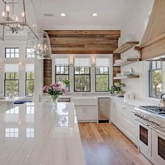 What makes a beautiful modern farmhouse kitchen? Here we feature some of the most prevalent, and important, key elements of modern farmhouse kitchen design that we are seeing in some of the most stunning kitchens today Home Decor Kitchen, Interior Design Kitchen, Kitchen Walls, Windows In Kitchen, Fireplace In Kitchen, Living Room And Kitchen Together, Farmhouse Windows, Big Kitchen, White House Interior