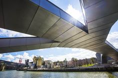 Bilbao's Pedro Arrupe footbridge with a view of the Guggenheim on the banks of Rio Nervión