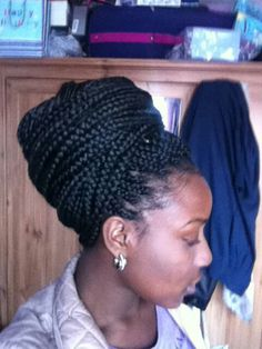 Box braids - I like how she has them wrapped around her head to give the illusion of having a headwrap on.  ~beautiful~