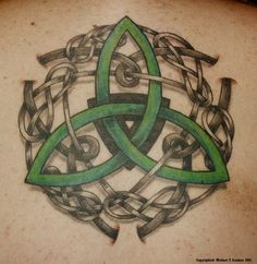 Custom Celtic tattoo on upper back