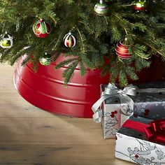 Glossy Red Tree Collar   Crate and Barrel - nice idea instead of a tree skirt - easier to clean and no straightening. However, have to put on first - if tree already set-up, impossible/ no hinge.