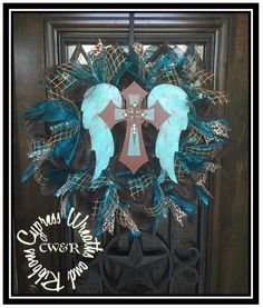 WR-2119 Turquoise and Brown Angel Wings and Cross Wreath Hand Painted. 24 inches diameter This can be done in any color. We make custom crosses, angel wings and more. Just ask us! Sales@cypresswreaths