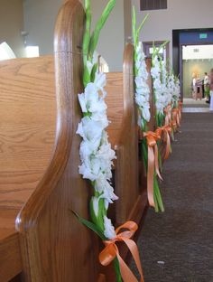 Gladiola aisle markers- maybe use orange flowers and grey ribbon?