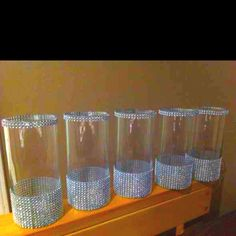 Love love love. Vases from dollar tree And add bling all over!