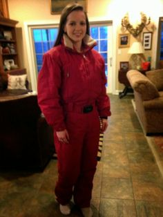 Aynsley in a Spanish red belted onesie.  (Front View) [ORIGIN VERSION]