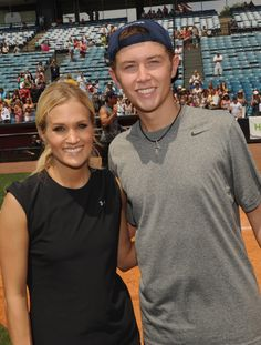 Carrie Underwood & Scotty McCreery,   NASHVILLE, TN - JUNE 09: Country artists Carrie Underwood and Scotty McCreery attend City of Hope's 22nd annual Celebrity Softball Challenge during CMA Fest on June 9, 2012 in Nashville . (Photo by Rick Diamond/Getty Images for City of Hope) , 2012
