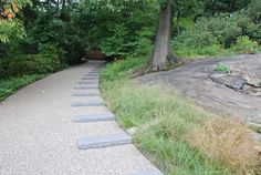 he paths are made with Gravel-Lok, a sustainable material that allows rainwater to filter through without puddling.