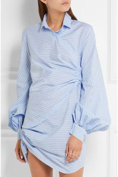 We love French label Jacquemus' unique and contemporary take on wardrobe classics. This striped sky-blue dress is designed to resemble a deconstructed men's shirt. It's masterfully cut from crisp cotton-poplin and detailed with origami-like folds and balloon sleeves - exaggerated proportions are a brand signature.