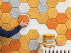 Awesome wall tiles made from wood wool and cement. Perfect for sound proofing rooms of teenagers who like loud music