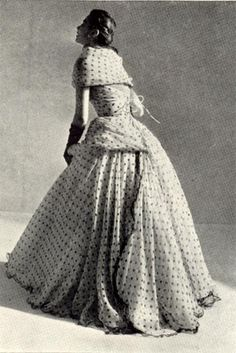 Balmain 1952  Black penny spots on white chifon over a crinoline of pink tulle.  Corseted bodice. Spring Collection 1952.