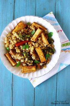 Quinoa, Tofu & Vegetable Stir Fry. Add pan seared tofu and vegetables for a healthy, filling meal.