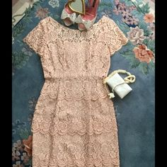 """Lace Vintage Dress 1950's SUMMER SALE So proud to share this beauty. Tiered lace in a beige with a pinkish tint (to me). Third picture closest to color. Slight discoloration in armpit area ( hard to see). It was dry leaned. No tags in it...estimated to fit 6 to 8. Lots of side seams to let out and adjust. side zipper. Waist 30"""" Bust 36 -38"""" From waist to hem bottom 29"""". Skirt is an A line not gathered, see comments for more info Vintage Dresses Midi"""