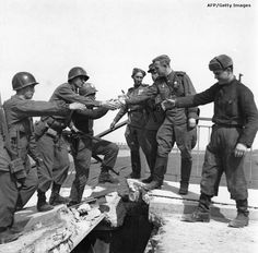 American and Soviet troops meet at the River Elbe, April 25th, 1945. WWII