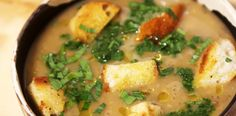 Supa de ciuperci cu crutoane, leustean si sos de leurda.