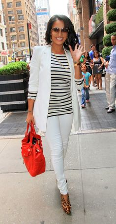 LaLa Anthony... black and white ensemble with leopard booties and red tote...