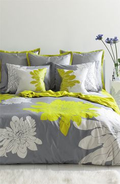 Pretty floral bedding in grey, white, and #citron http://rstyle.me/n/hamnhnyg6