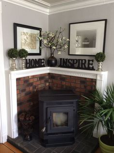 corner pellet stove ideas | Corner pellet stove. Changed out wall color and added plants,for a ...