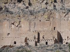 New Mexico Ruins/Cliff Dwellings at Puye Cliffs - The Puye Cliffs complex, the largest complex on the Pajarito Plateau, includes two levels of cliff-dwellings and surface and cave dwellings. The two levels of cliff dwellings, the mesa top and reconstructed 'Community House' are accessed by paths and about twelve stairways and ladders cut into the side of the cliff. One level of cliff dwellings is over 1 mile long and the second is about 2,100 feet long.