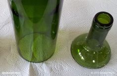 The best way to cut a glass bottle has been around for over 2,000 years. It's called Cracking Off. Pictures and video at www.naturalhomes.org/cracking-off.htm