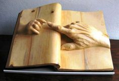 'The book of life' Wood sculpture by Nino Orland