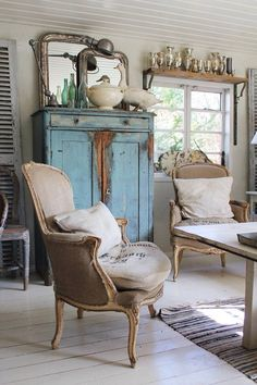 Vintage Living Room: Collections of vintage bottles, vases and mirrors are thoughtfully displayed in this French inspired room.