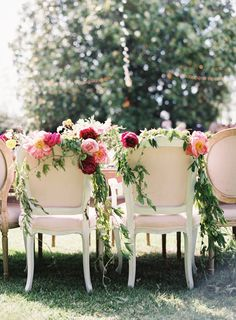 Romantic peony + garland topped sweetheart chairs: http://www.stylemepretty.com/2016/02/25/colorful-spring-garden-wedding-in-sonoma-valley/ | Photography: Brett Heidebrecht - http://brettheidebrecht.com/