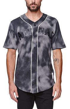 Adidas supplies a tie dye men's baseball jersey found at PacSun. The7 And A Half Baseball Jersey for men comes with a black Adidas logo print on the front, along with some white piping.   Tie dye baseball jersey with Adidas logo on front Button front Short sleeves Regular fit Machine washable 100% cotton Imported