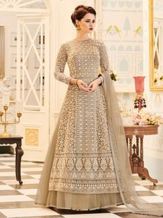 Finest beige mono net anarkali style suit designed with embroidery, resham, zari and hand work also come with a matching santoon bottom and chiffon dupatta. Shop this alluring anarkali outfit at affordable price with free shipping to USA, UK, Canada and Worldwide.