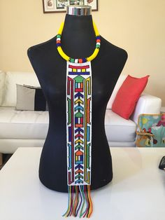 Unisex Ndebele beaded necklace This is a top of the range, elegantly beaded necklace carrying dramatic Ndebele pattern. It can be worn on any outfit ( formal or casual). Xhosa Attire, African Attire, African Fashion Dresses, African Necklace, African Beads, African Jewelry, African Art, Mens Chain Necklace, Initial Necklace