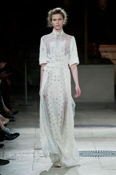 """Polish designer Gosia Baczyńska, who sometimes is called by her fashion friends """"fashion tsarina"""", likes to work with different materials. She gets her embroideries, laces and prints from the same places, where the famous couture houses like Hermès, Chanel, Givenchy and Balenciaga order. Gosia Baczyńska believes that there are no boundaries between art and clothing. Read More »"""